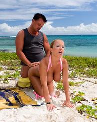 Big tit blonde babe in pink bikini fucking cock by the sea