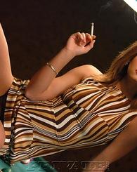 Beautiful sexy smoking girl posing on the pool table for us