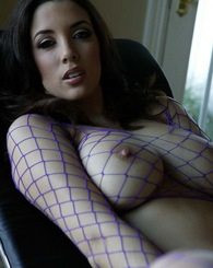 Big breasted Jelena Jensen shows off her sexy body in fishnets and a mini skirt.