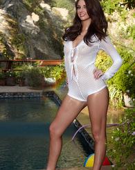 Katie Jordan enjoys getting wet by the pool