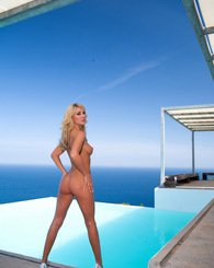 Beautiful blonde cutie shows her perfect body at Ibiza pool