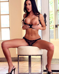 Brunette hottie, Laura Lee playing her pussy on her comfy chair